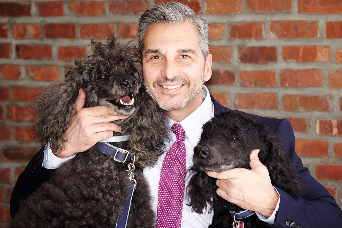 Dr. Sengos with 2 Dogs